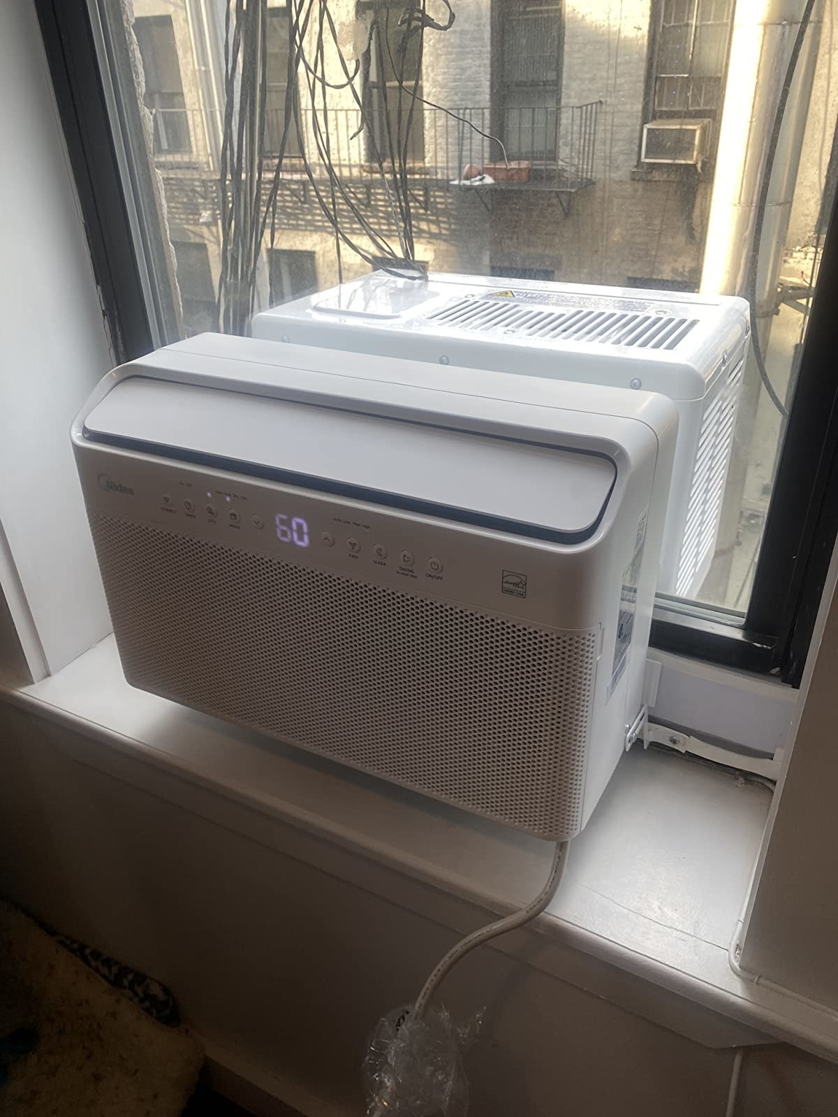 reviewer image of the midea U-shaped air conditioner installed in a window