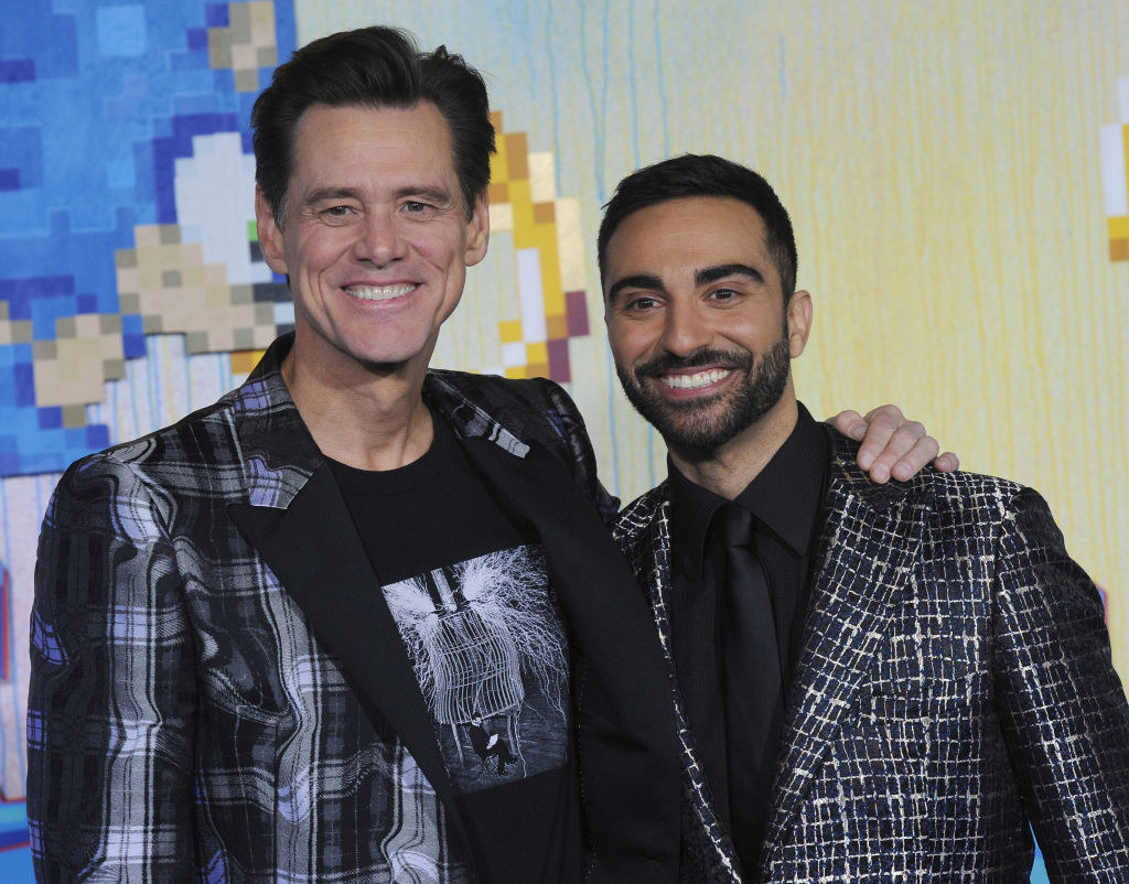 """On the """"Sonic"""" red carpet with his arm around Lee Majdoub"""