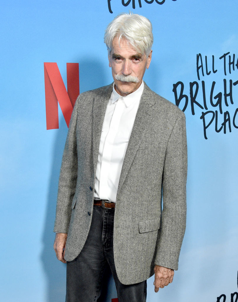 With white hair and mustache at a Netflix premiere