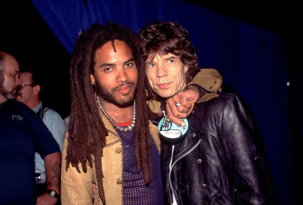 Wearing dreads and hugging Mick Jagger
