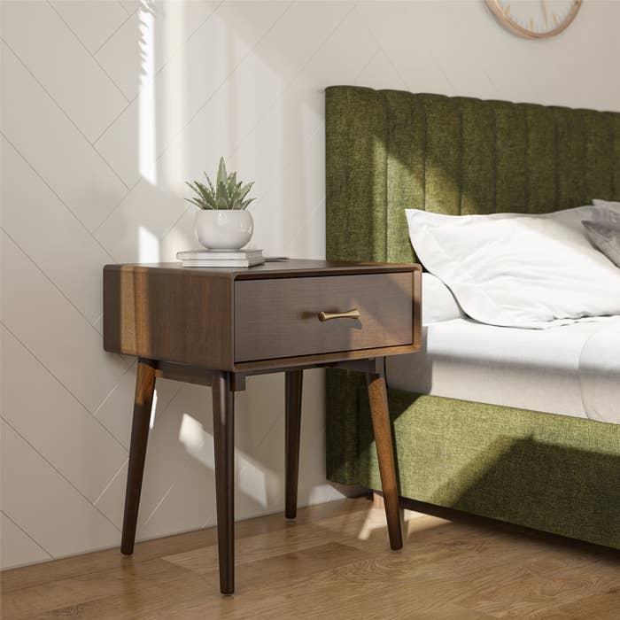 Brown one-drawer nightstand in trendy bedroom