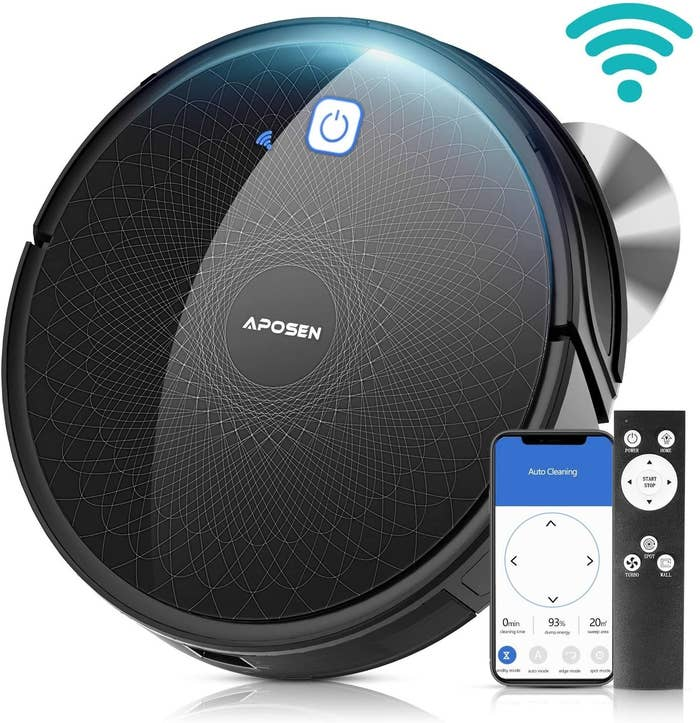 Black, circle robot vacuum cleaner and remote control
