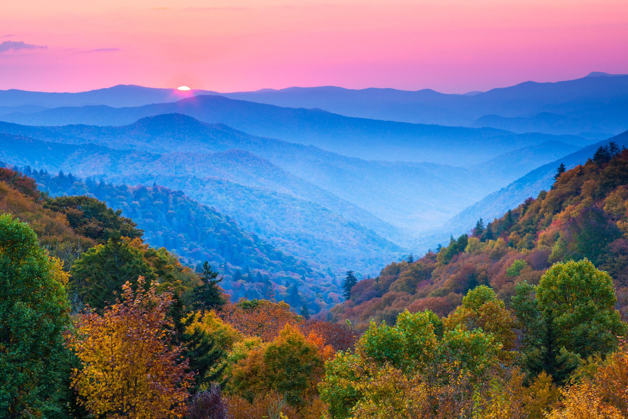 The sun setting over the mountain range