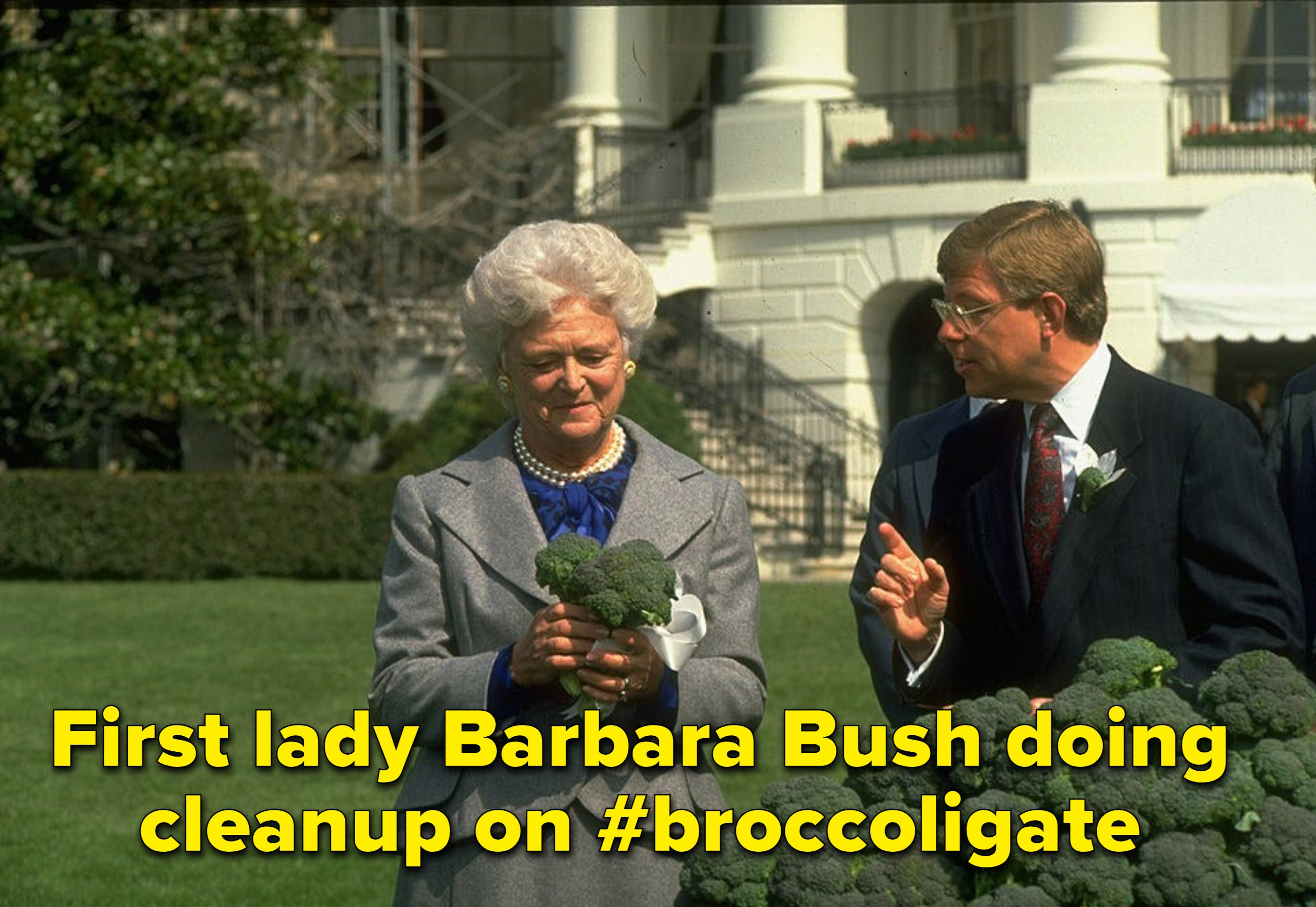 First lady barbara bush holds broccoli at a press conference trying to fix her husband's faux paus
