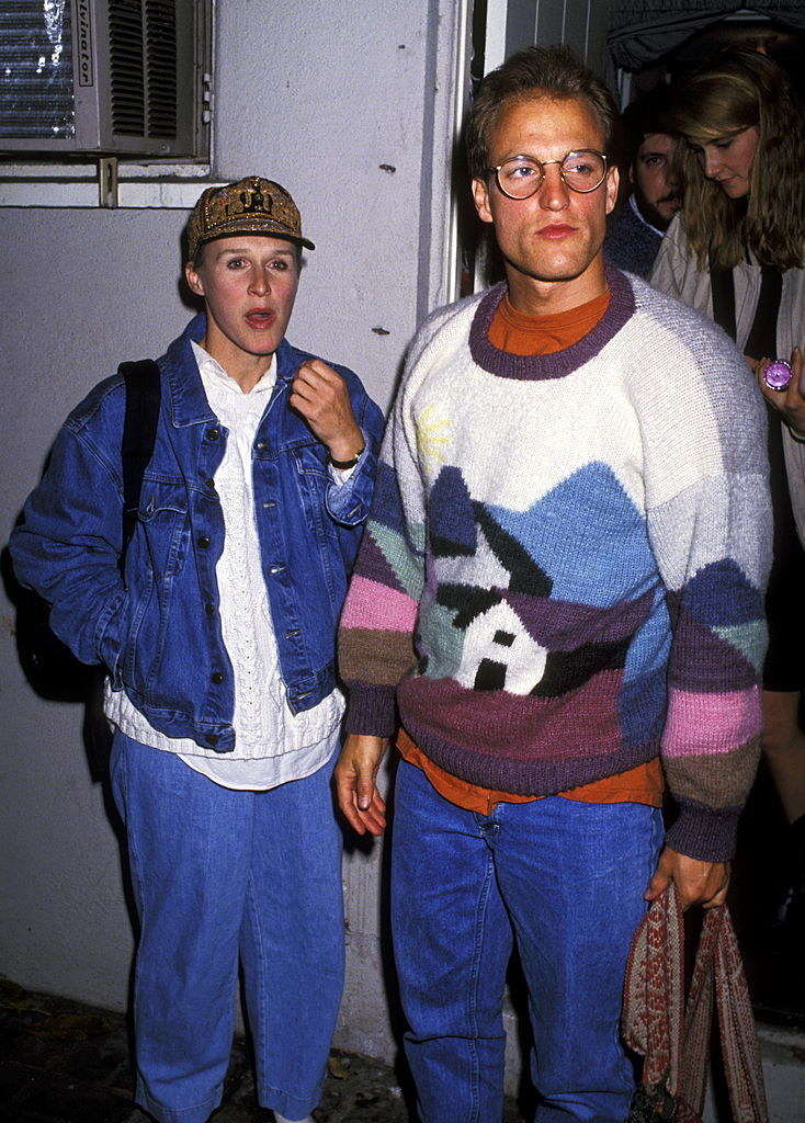 Wearing a very cozy sweater and standing next to Glenn Close in the early '90s