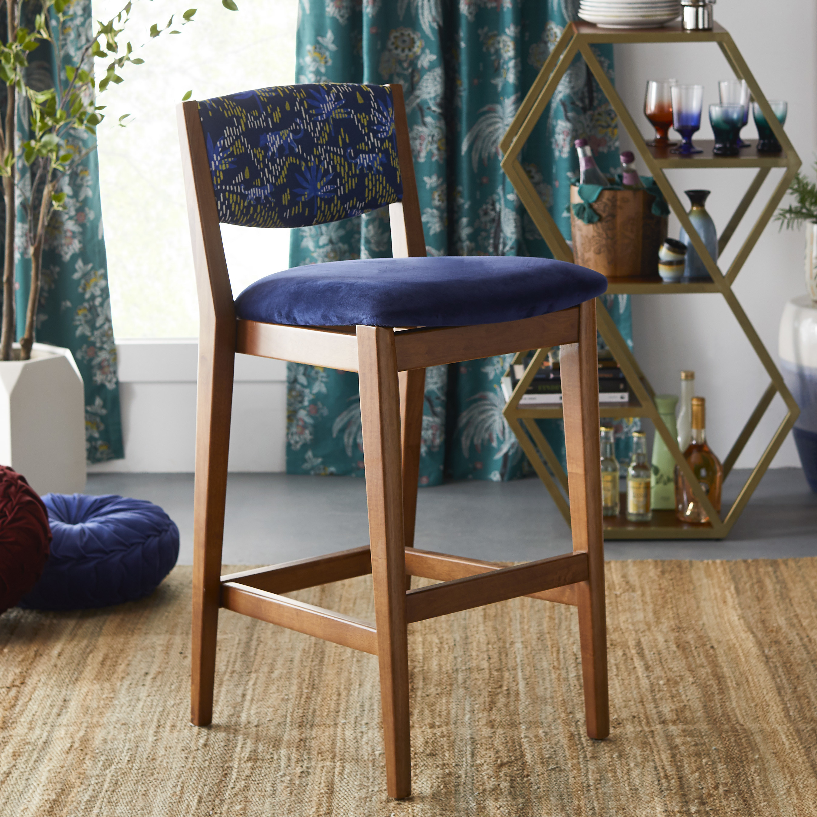 Blue and brown barstool in funky apartment