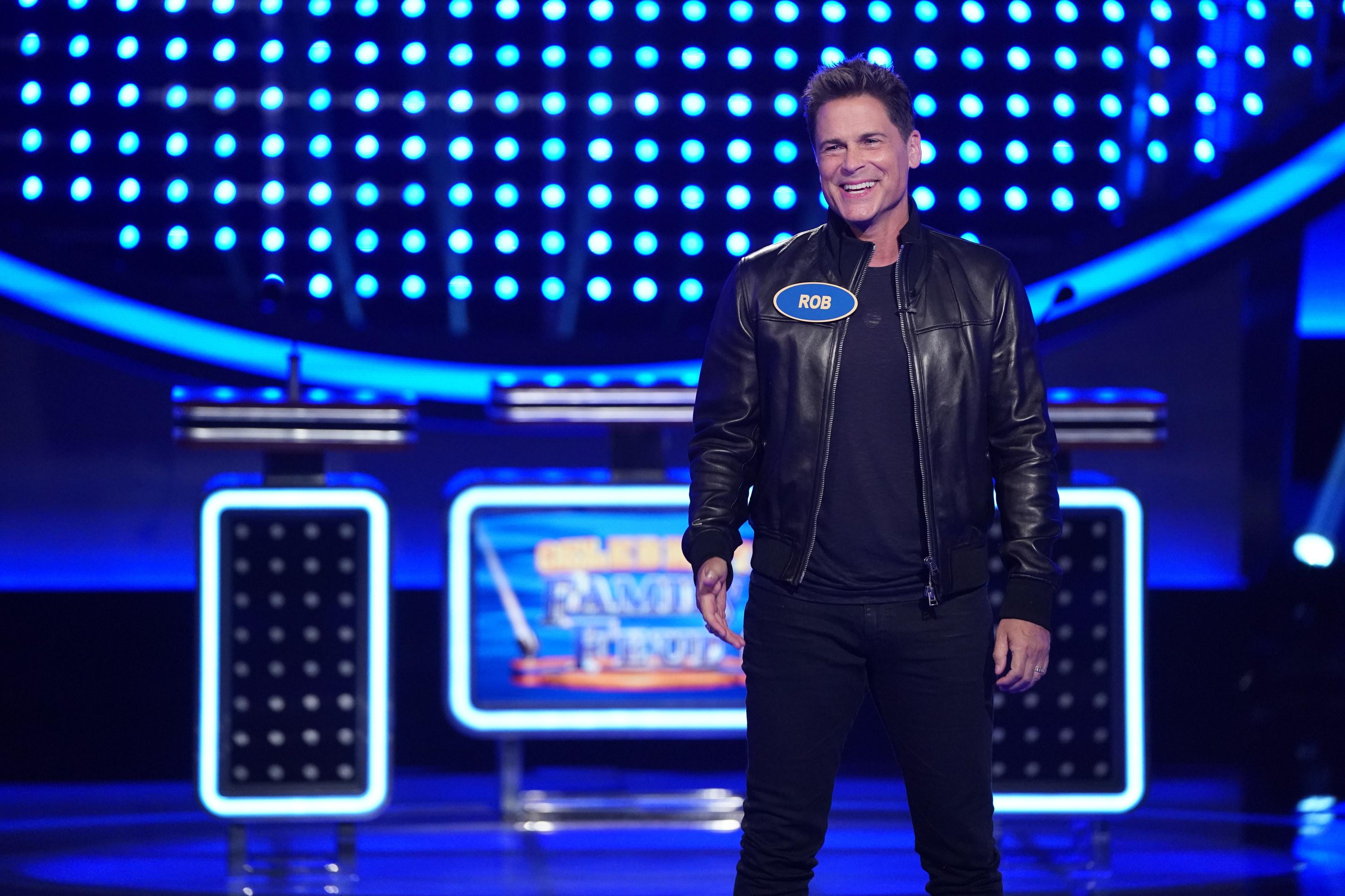 """Smiling in a black leather jacket on """"Family Feud"""""""