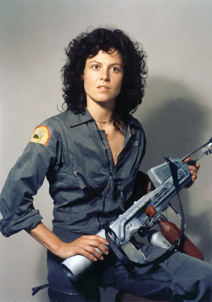 """Holding a weapon from the movie """"Alien"""""""