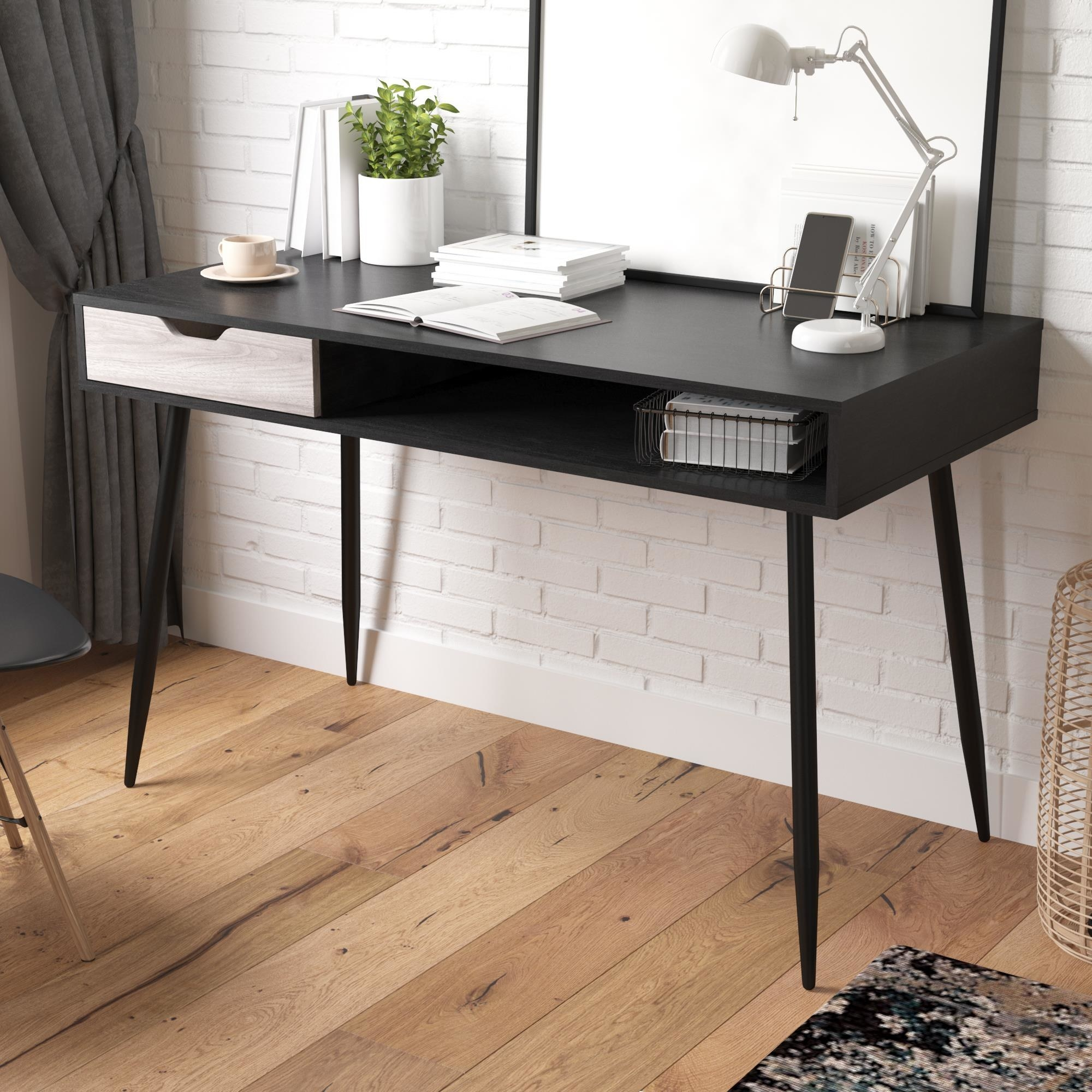 Black, thin writing desk in apartment