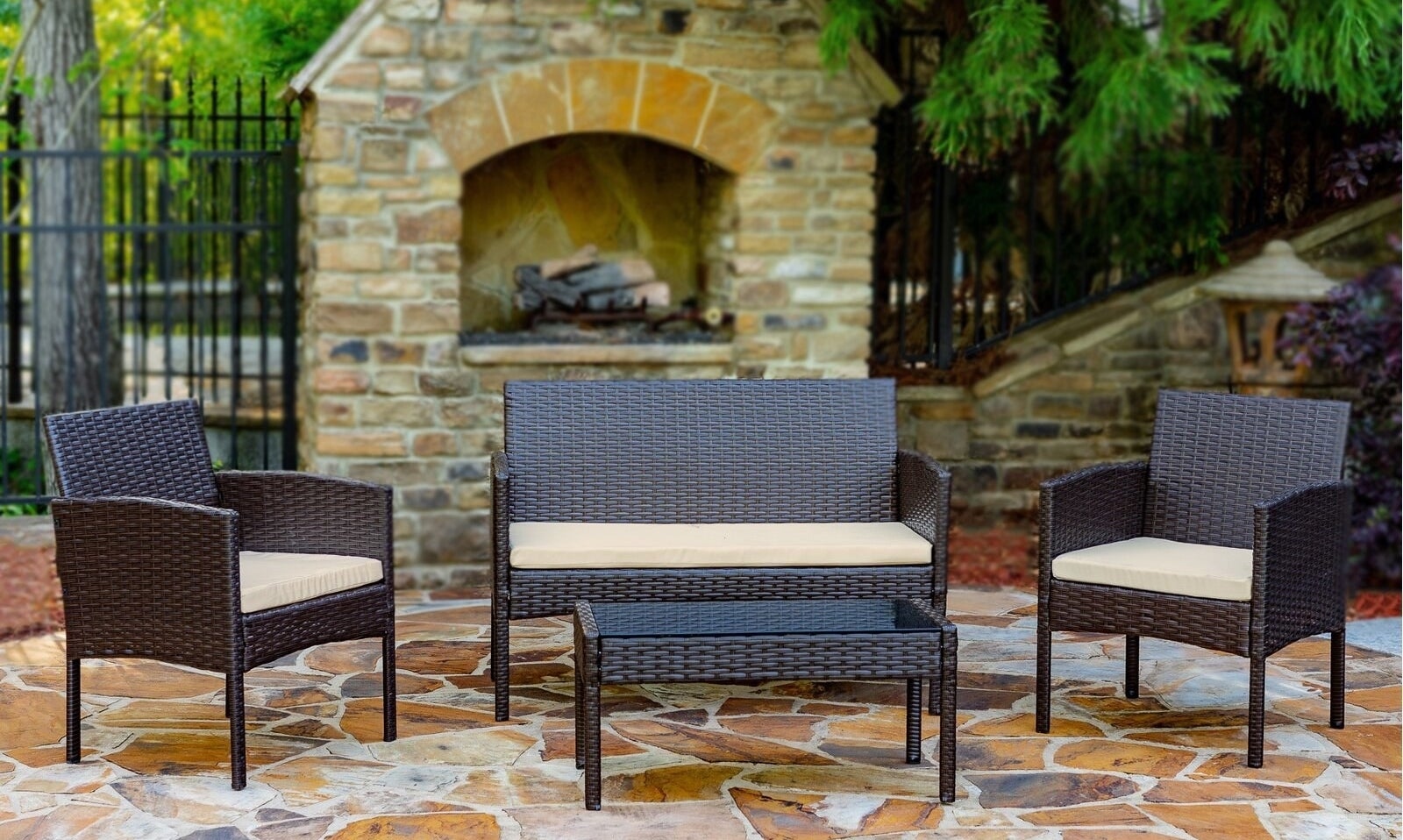 The brown patio set in front of an outdoor fireplace