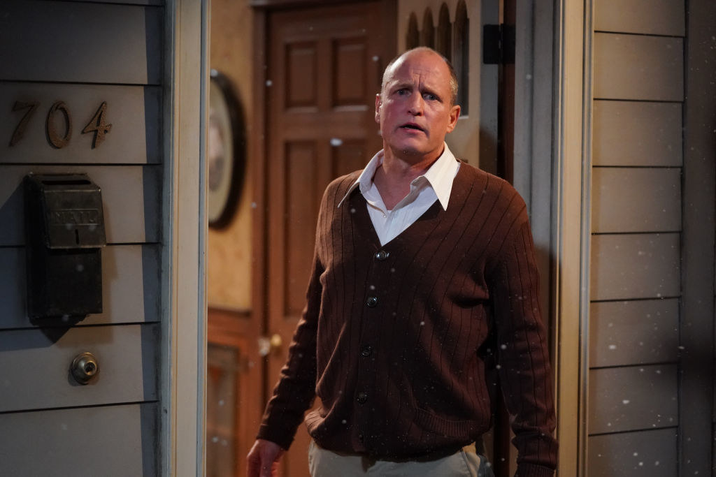 Wearing a sweater and standing in a doorway on a TV show in Cecember 2020