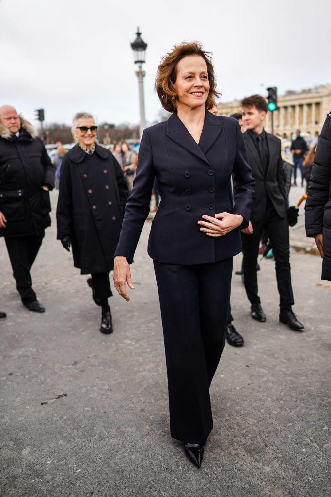 Wear a black pantsuit at Paris Fashion Week