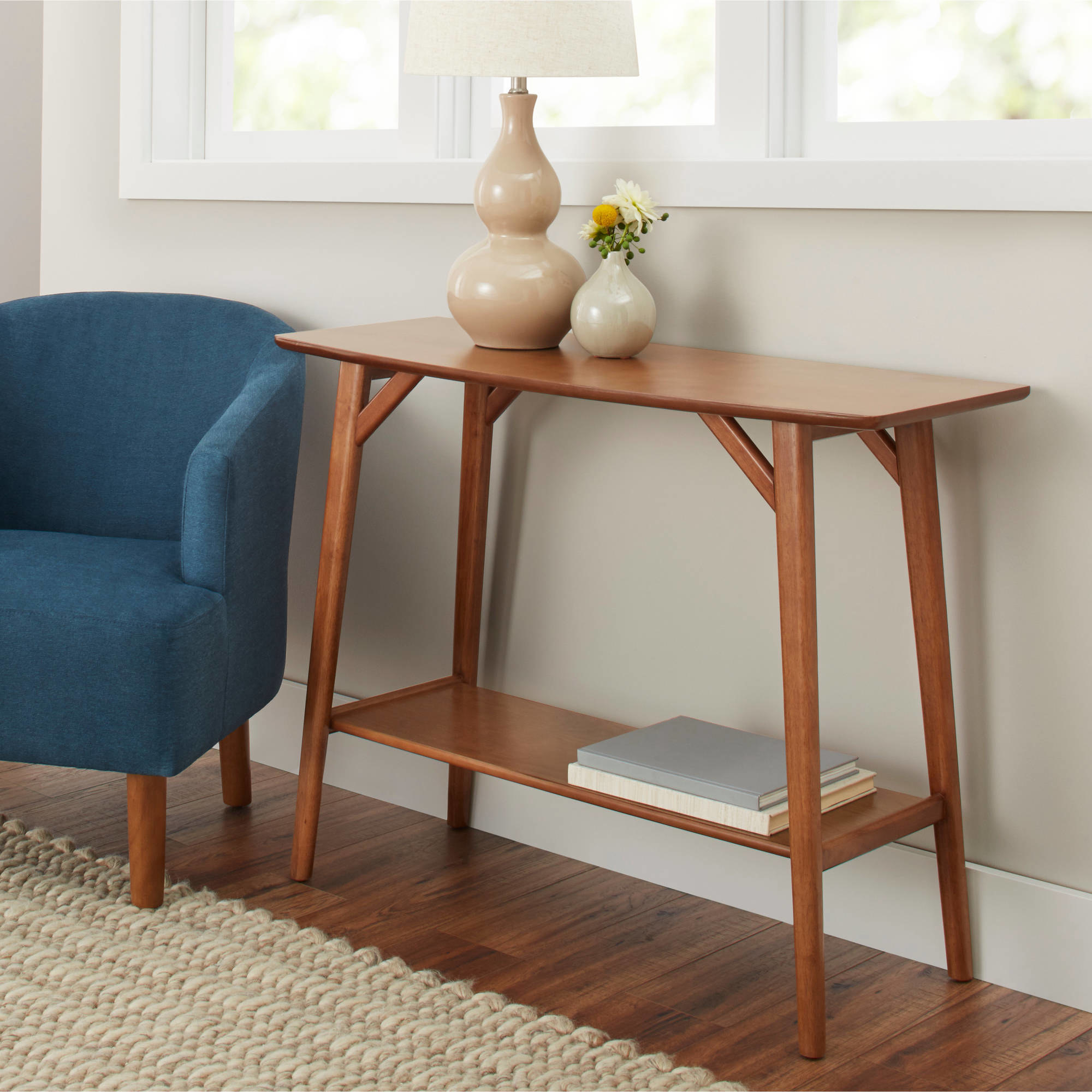 Brown thin table with books in warm living room