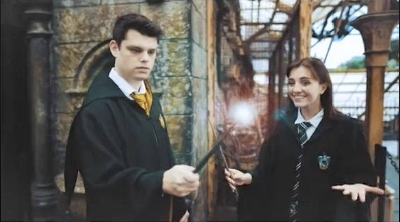 The couple holding their wands