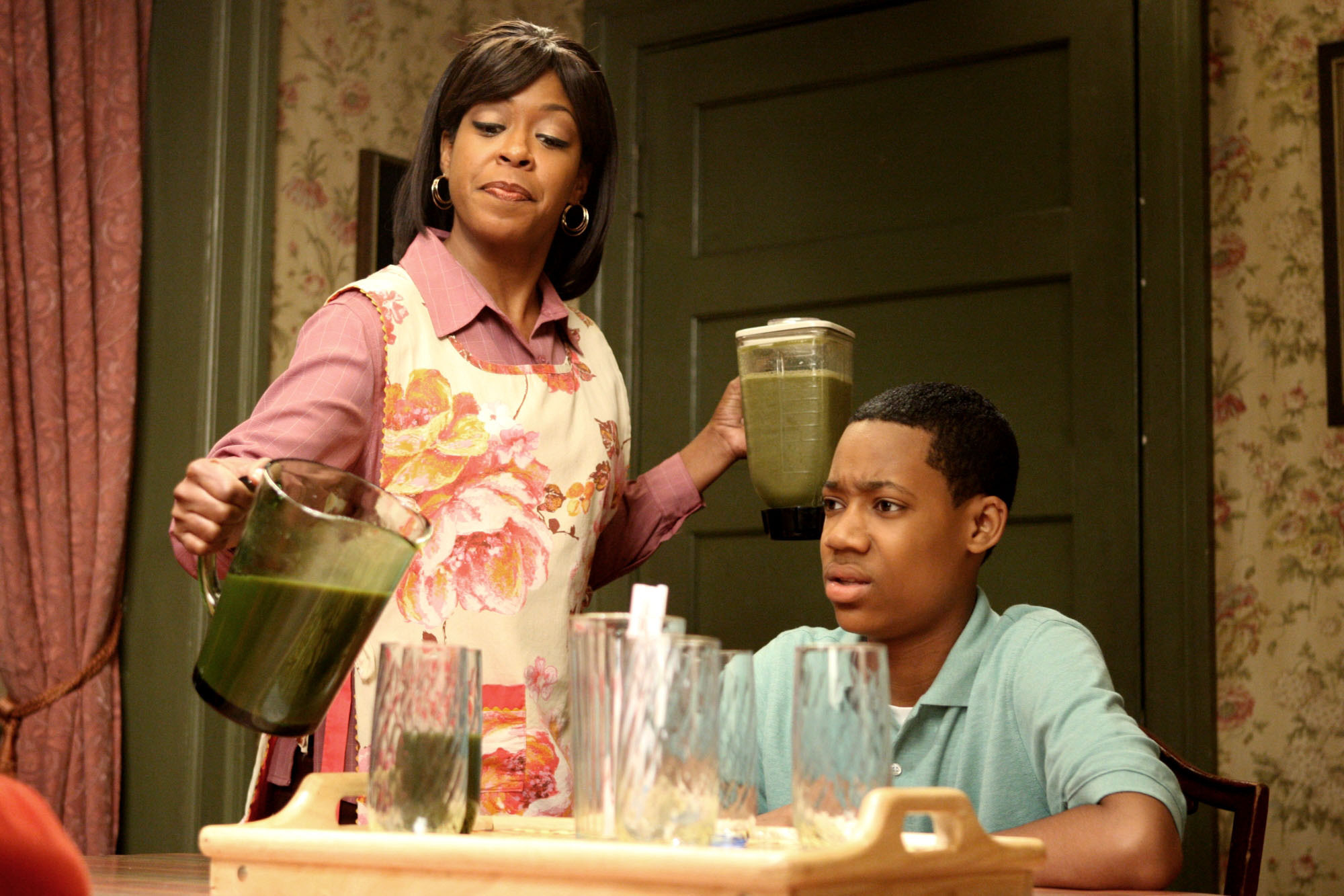Tichina Arnold pours Tyler James Williams a drink