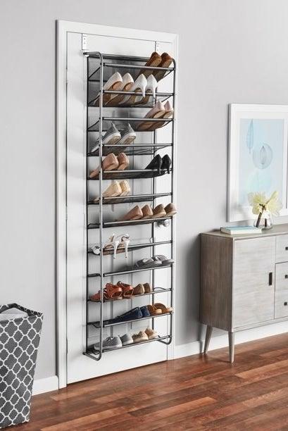 The shoe rack hanging on the back of a bedroom door