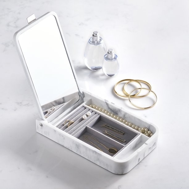 The open faux marble jewelry organizer with jewelry inside