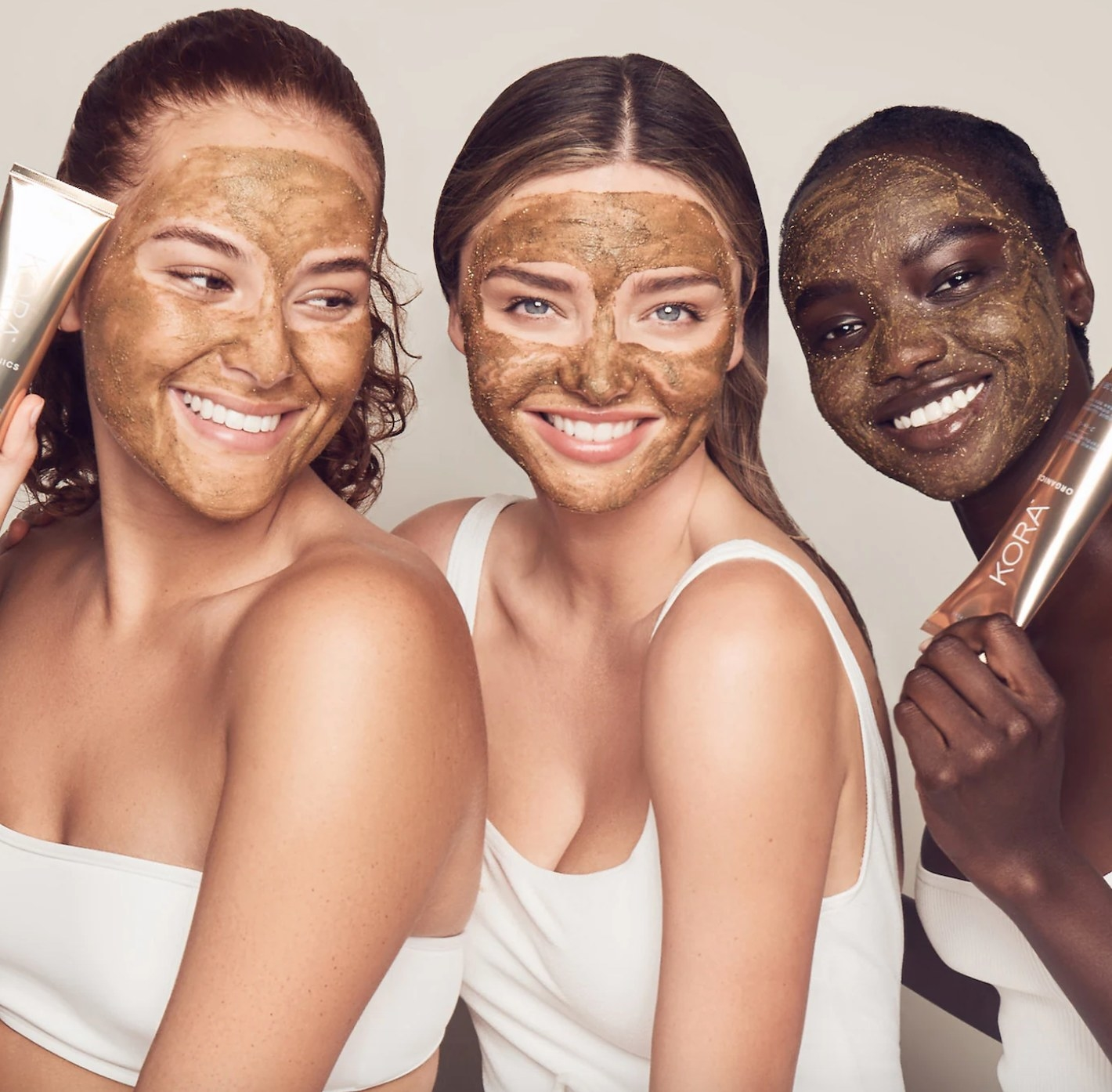 Miranda Kerr and two other models with Kora turmeric mask on their faces