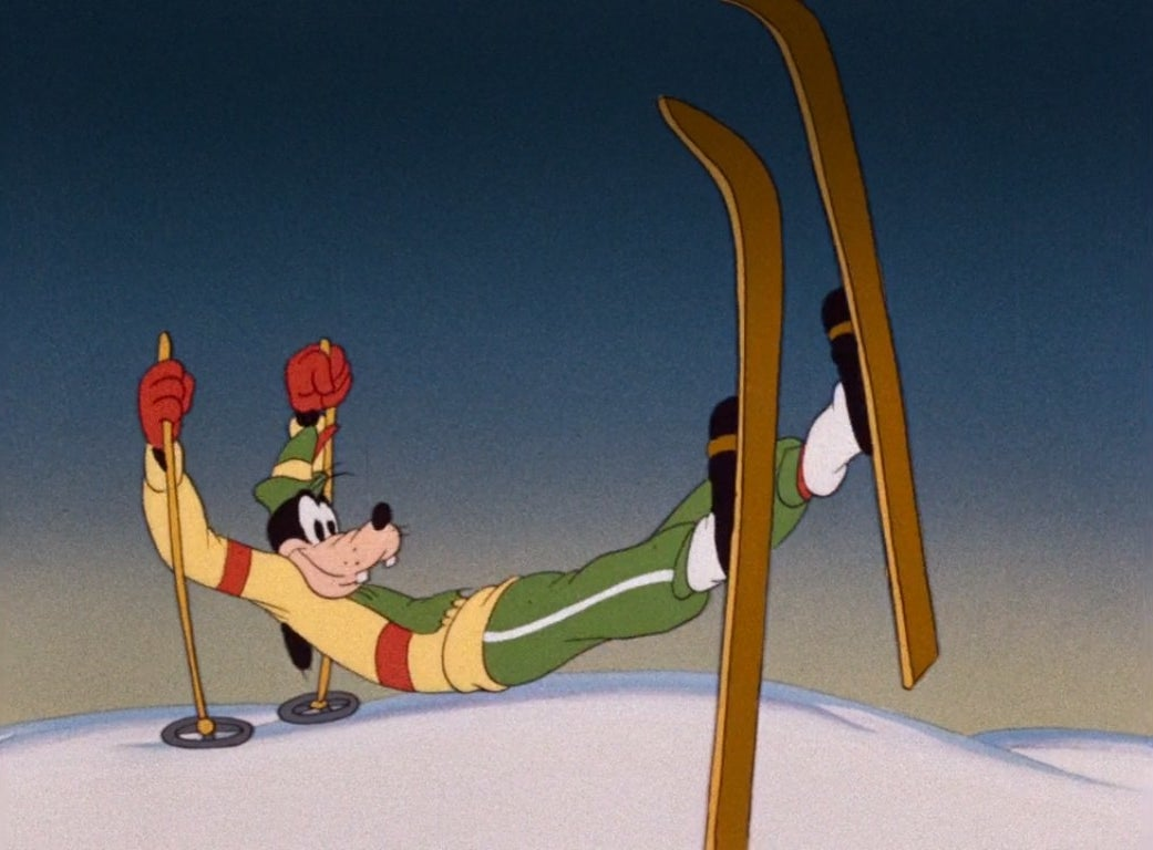 Goofy holds himself up with his skis and poles