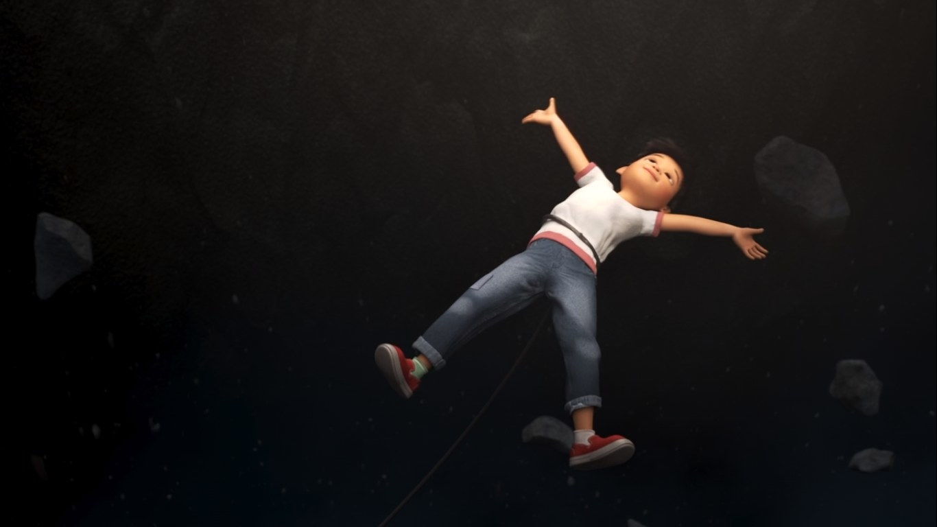 A boy floats through space