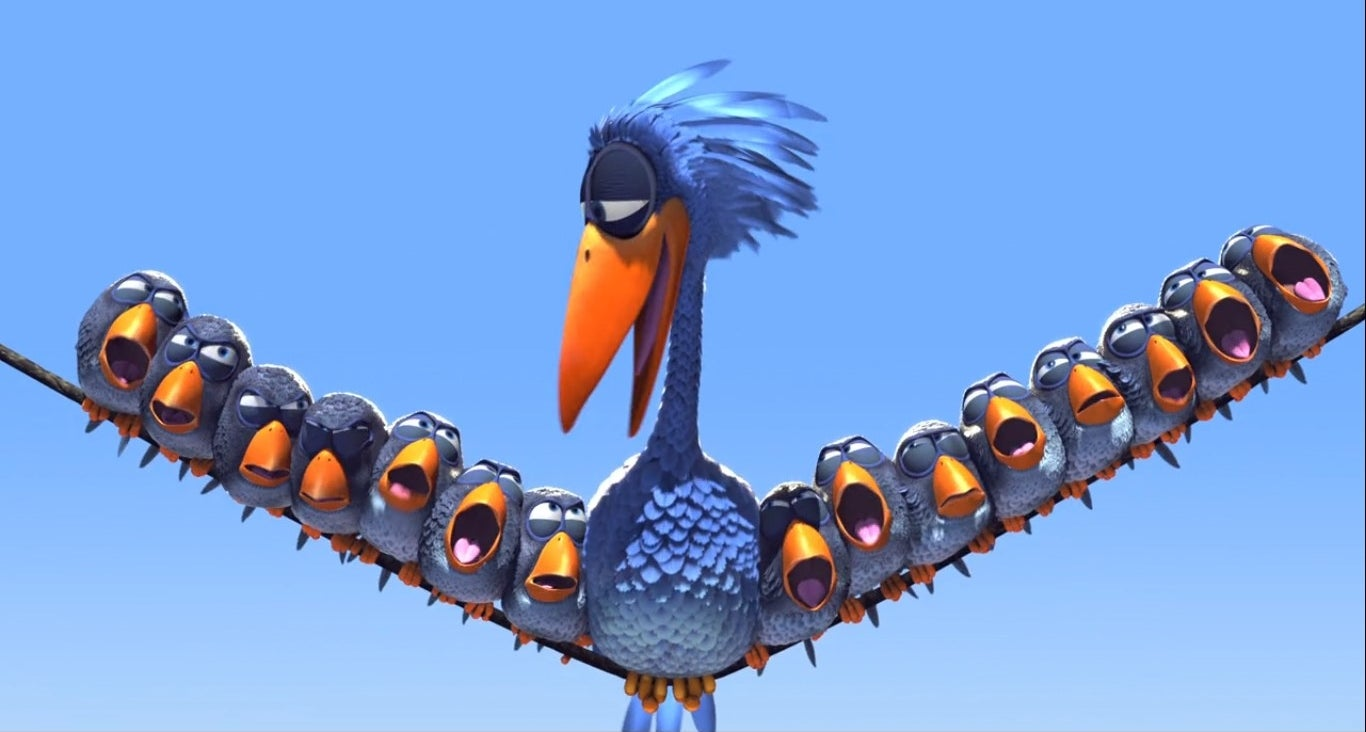 A large bird sits on a telephone wire with a bunch of smaller birds