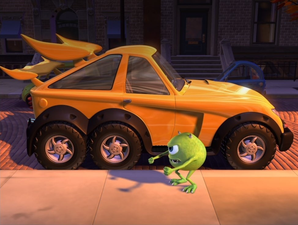 Mike Wazowski stands outside a brand new car