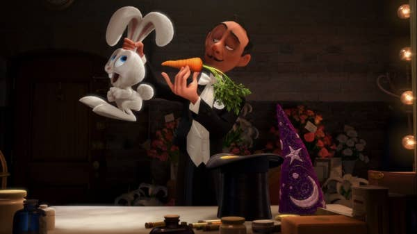 A magician attempts to feed a rabbit a carrot