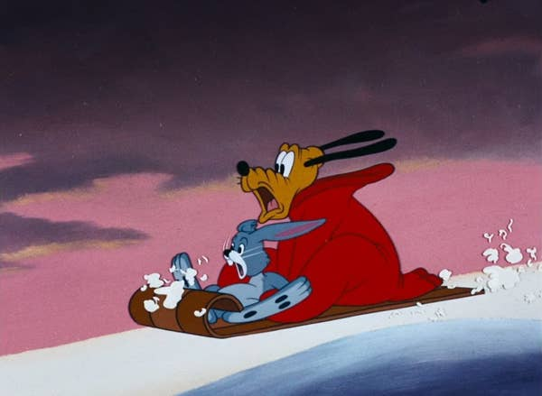 Pluto and a rabbit on a sled