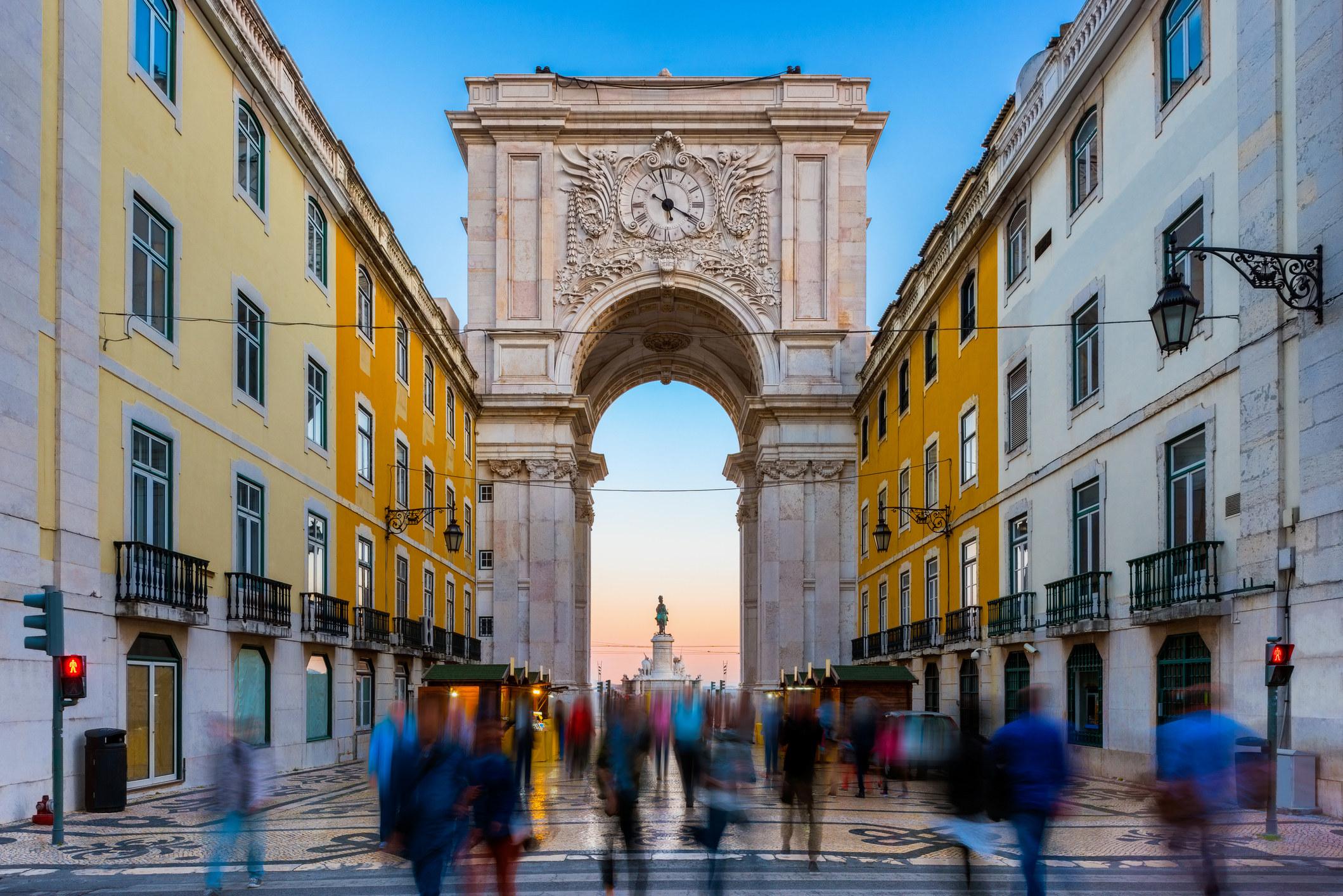 People walking in a plaza in Lisbon.