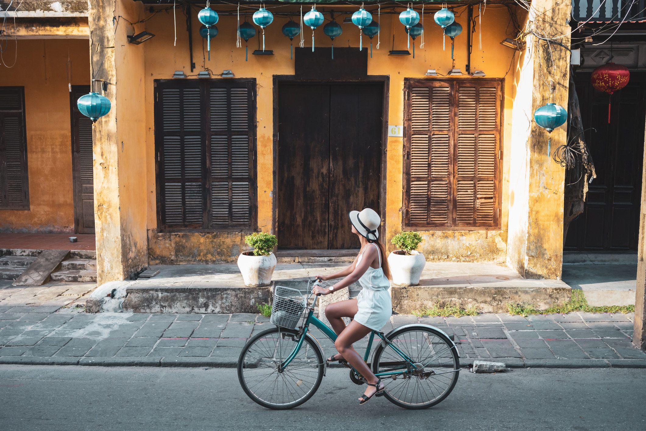 A woman bike riding in an Asian city