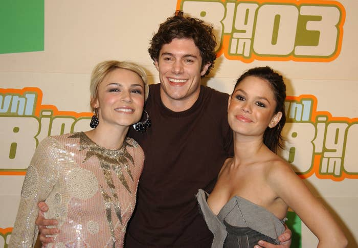 Adam poses between Samaire and Rachel at an event