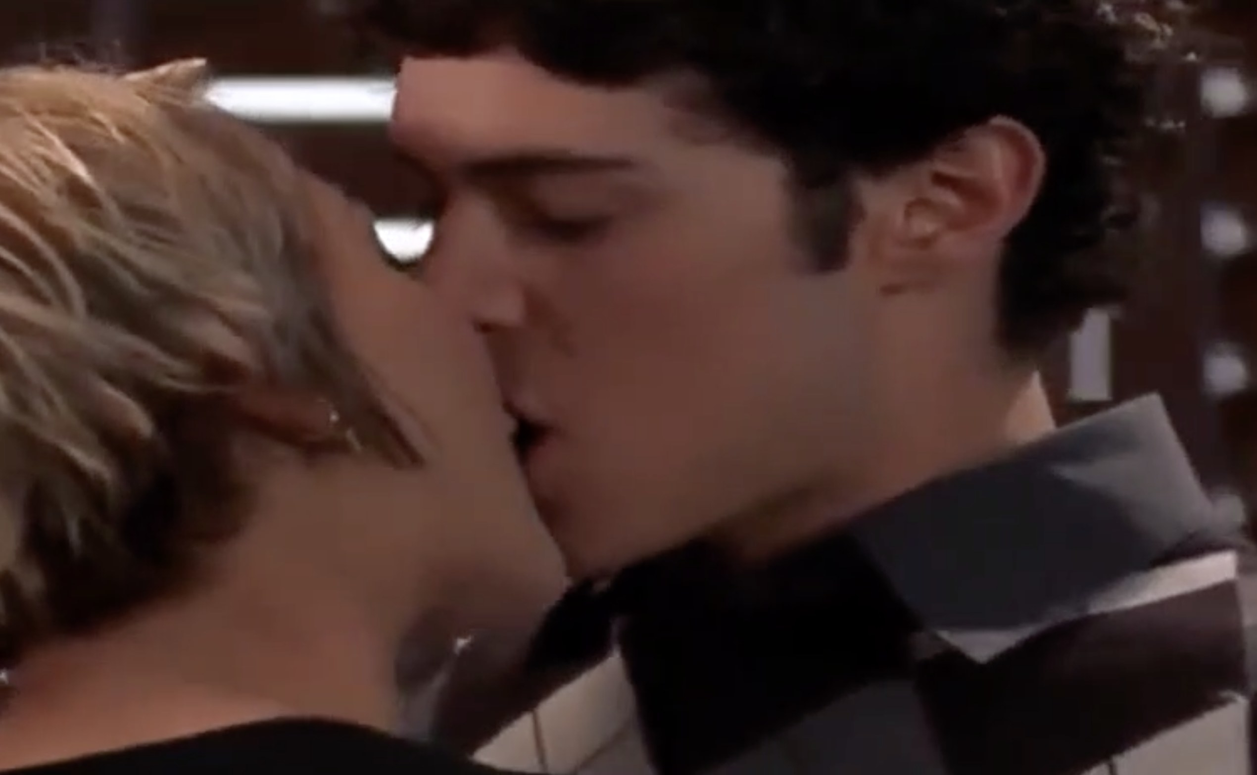Samaire and Adam's characters passionately kiss