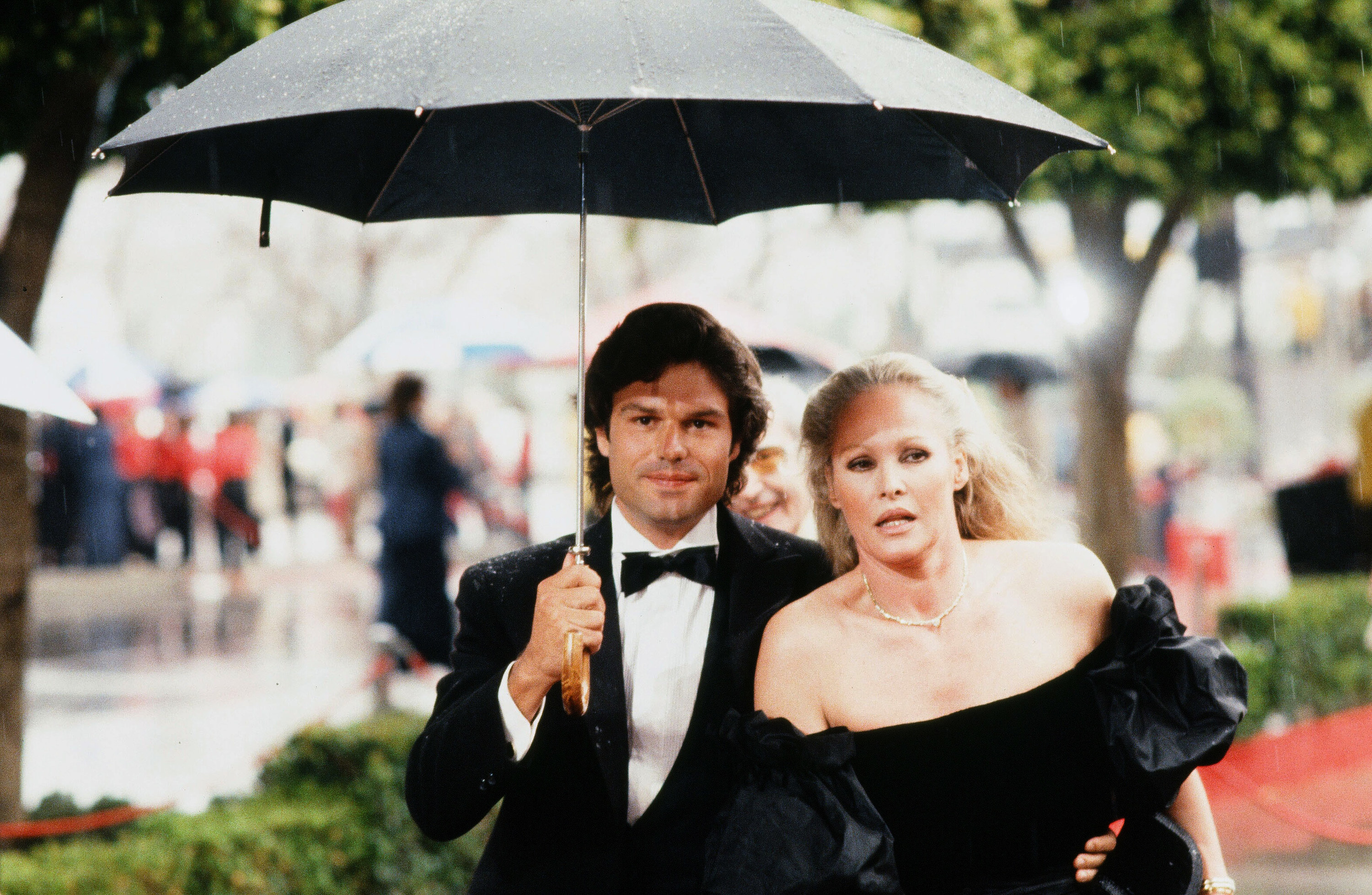Actress Ursula Andress with actor Harry Hamlin arrive to the 54th Academy Awards at Dorothy Chandler Pavilion in Los Angeles,California