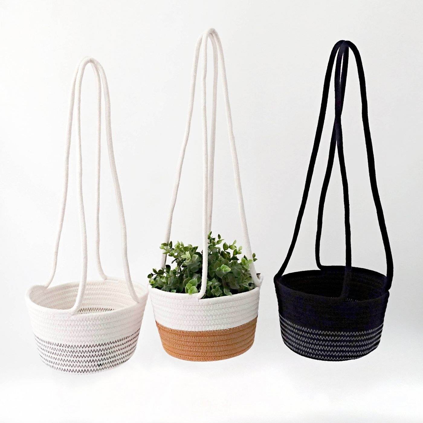 A white, tan/white and black hanging basket for your plants