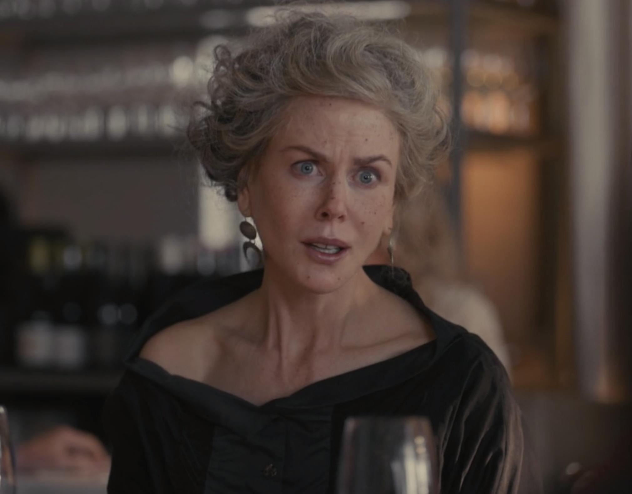 Nicole Kidman wearing a flimsy gray wig