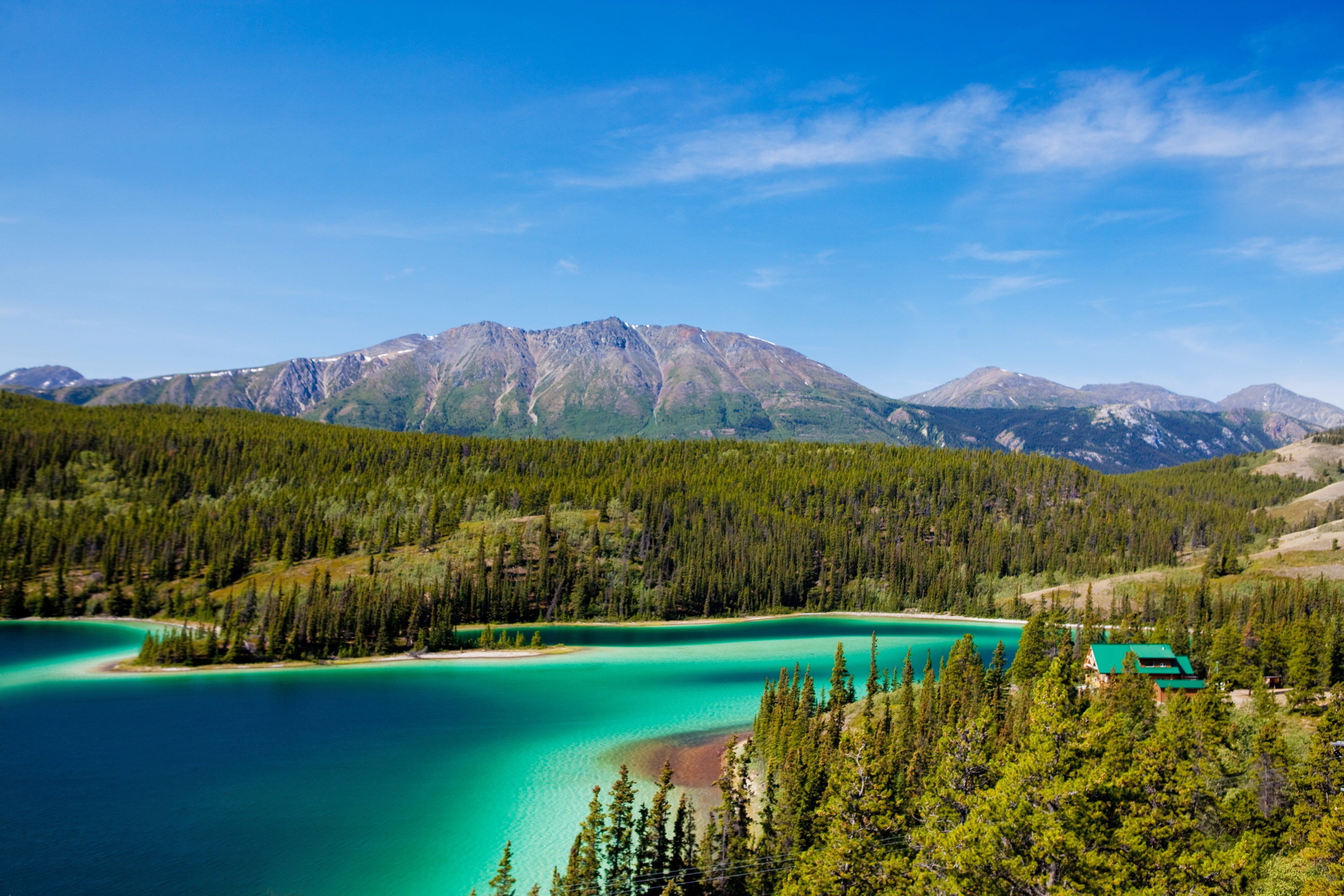 A wide view of Emerald Lake from an adjacent highway