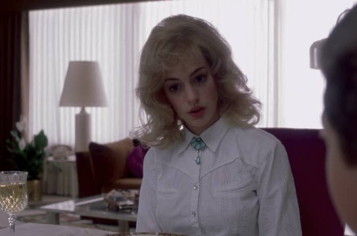 Anne Hathaway in a messy blond wig
