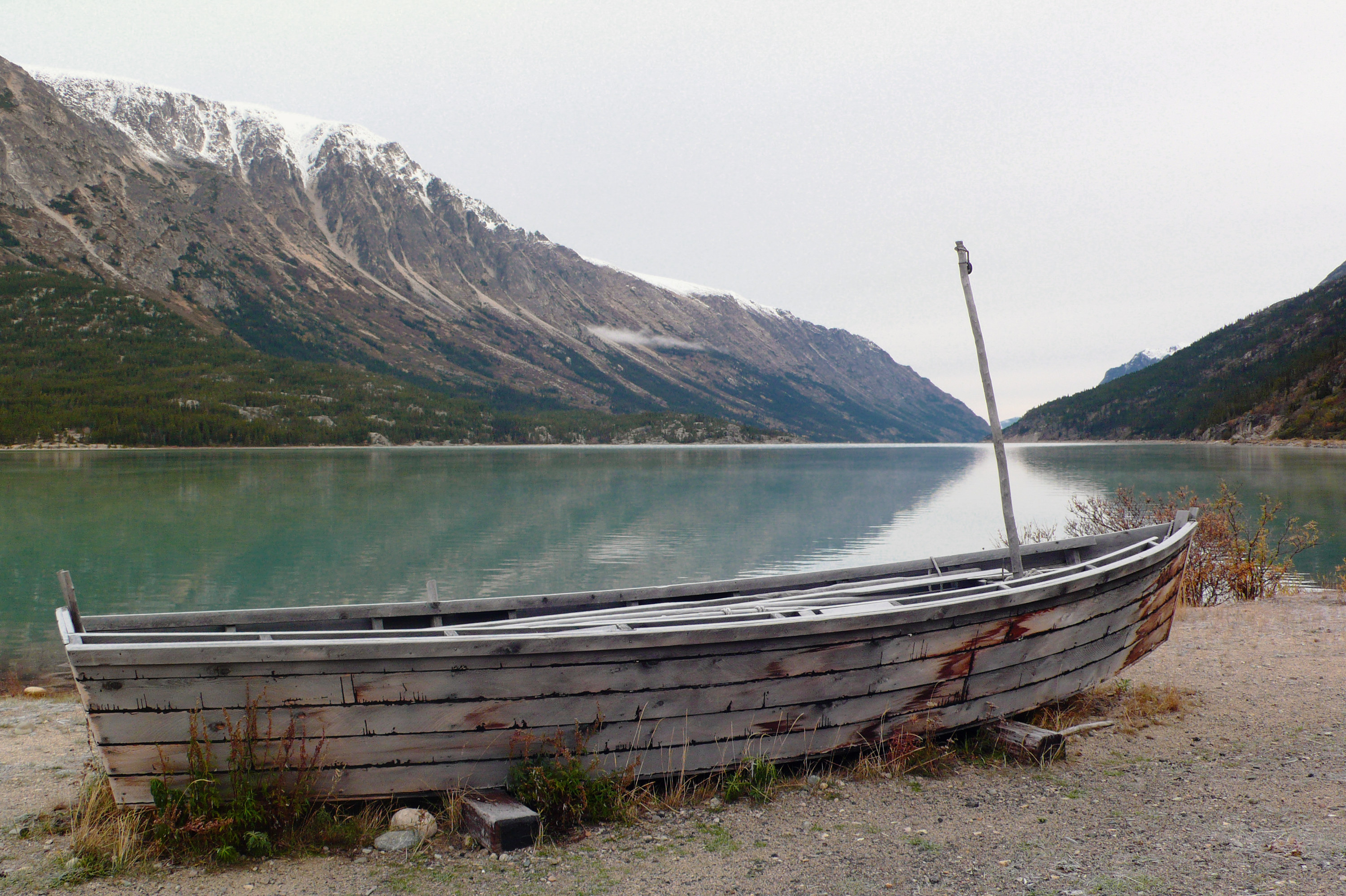 a boat next to the lake