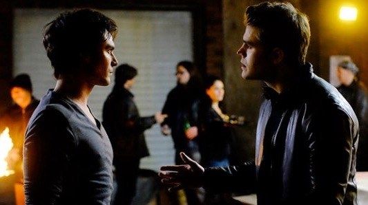 stefan and damon about to fight at a party in front of other people
