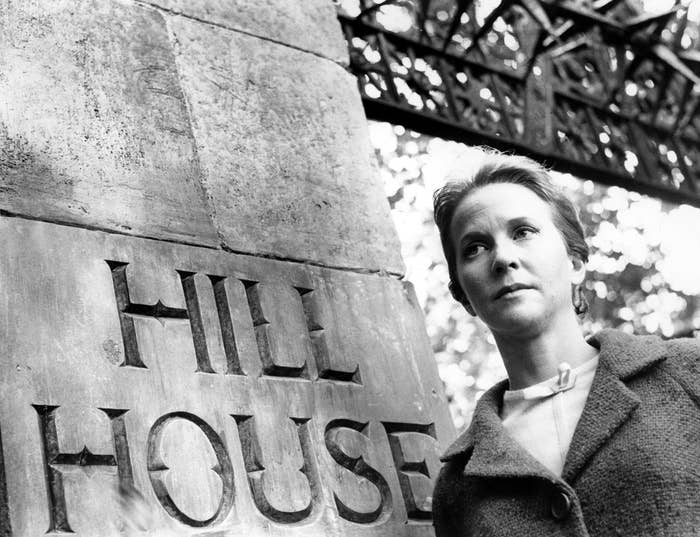 Julie Harris entering the gates of hill house wherewhatever walked there, walked alone