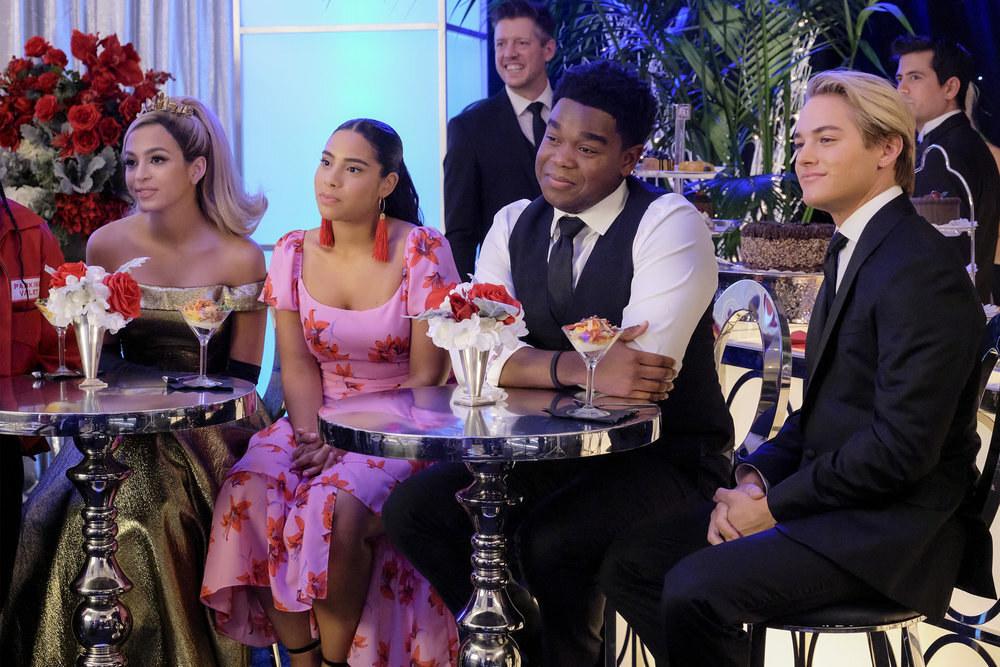Josie Totah, Haskiri Valazquez, Dexter Darden, and Mitchell Hoog sit at tables in formalwear