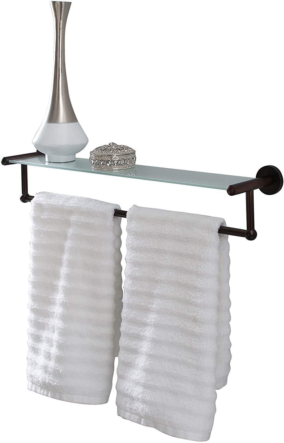 The shelf with a towel, vase and trinket displayed on it