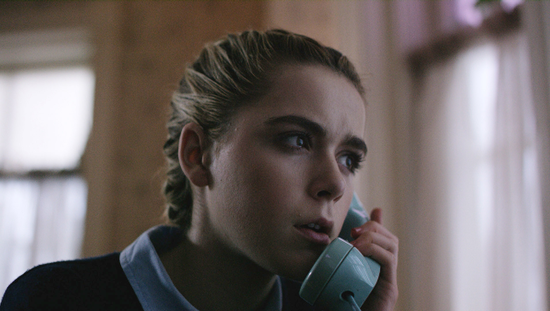 Kiernan looking concerned while talking on the phone