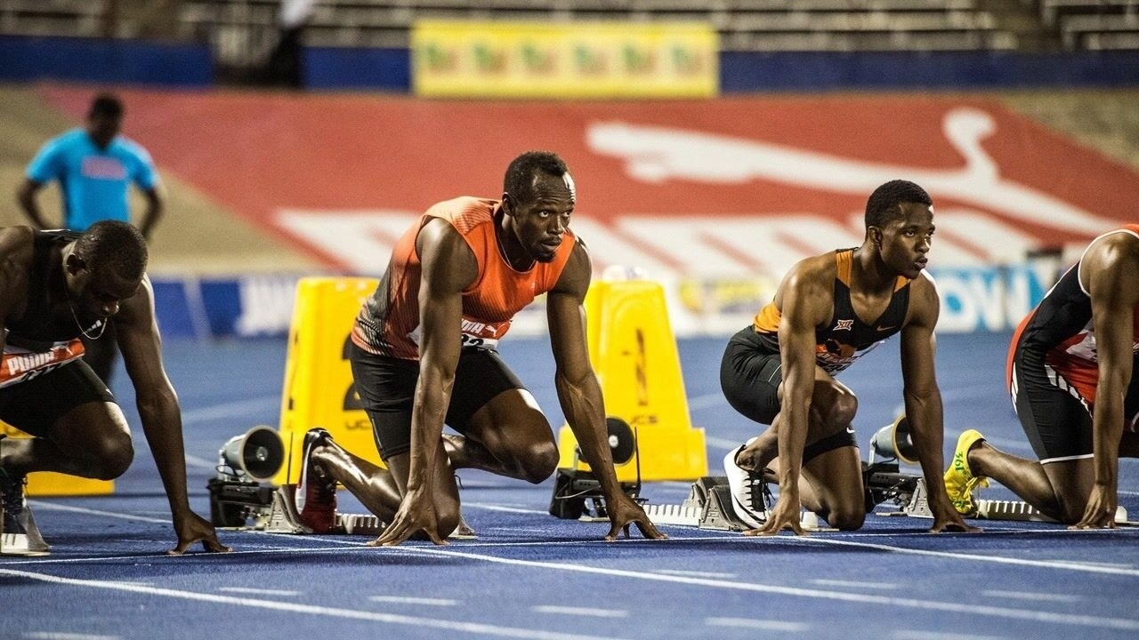 Usain Bolt and other runners at the starting line of a race