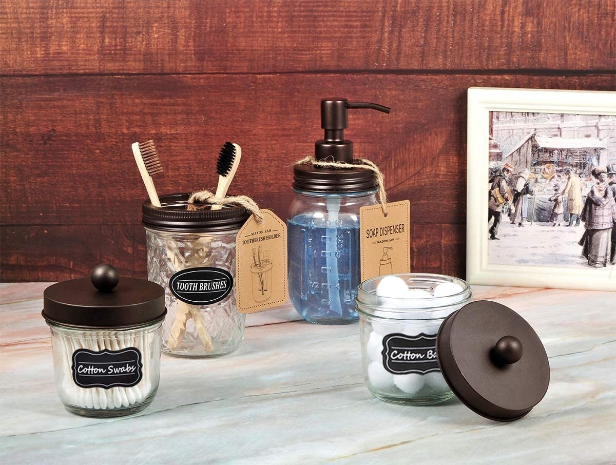 The set of mason jar accessories with toiletries inside of them