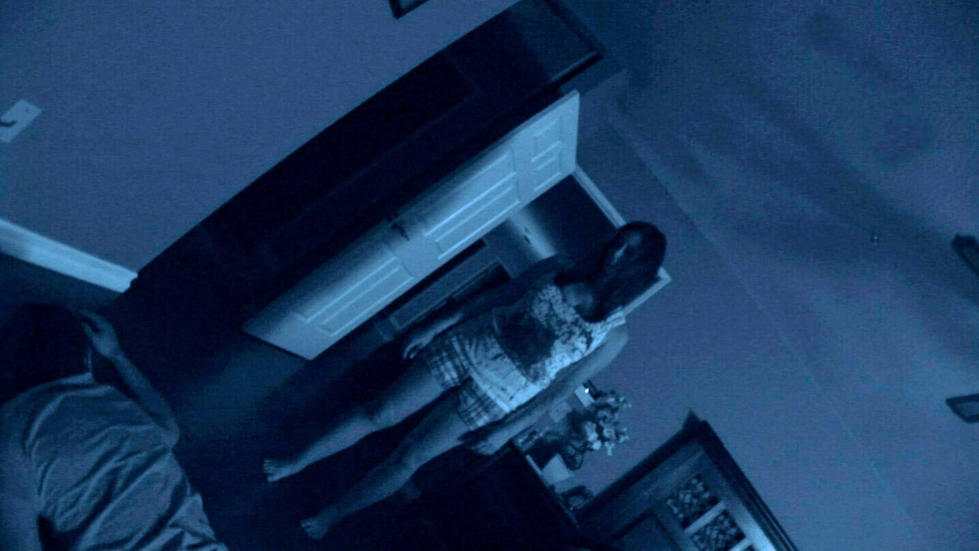 Katie eerily standing over the dead body of her husband