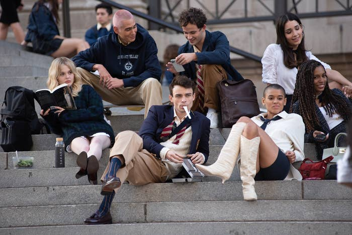 the new characters sitting on the Met steps
