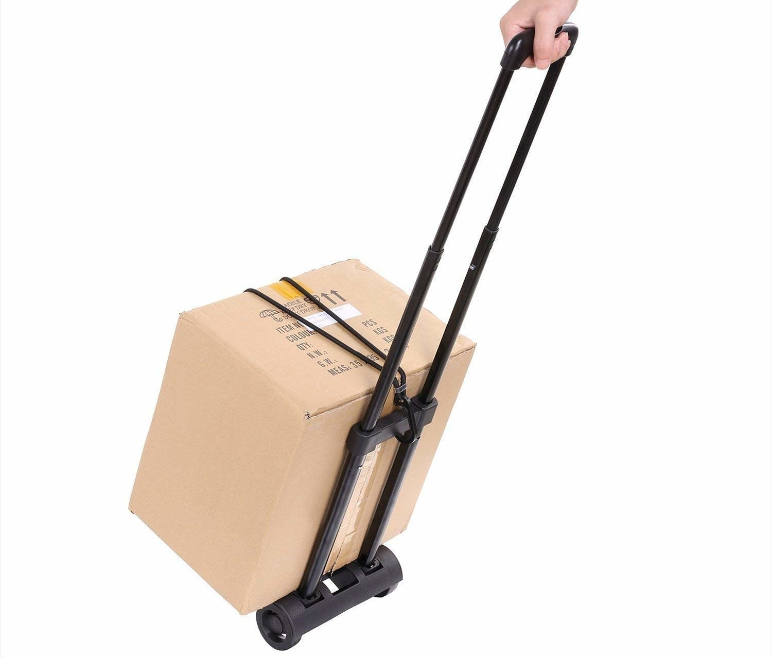 A person carrying a box using the luggage trolley cart