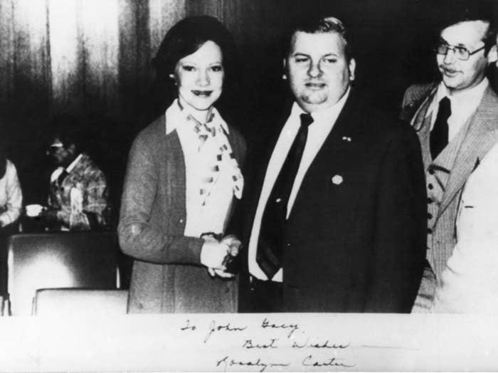 First Lady Rosalynn Carter shaking hands with serial killer John Wayne Gacy