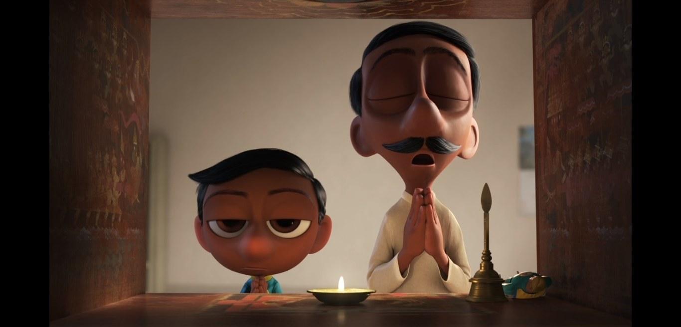 Sanjay and his father pray near a small Hindu shrine